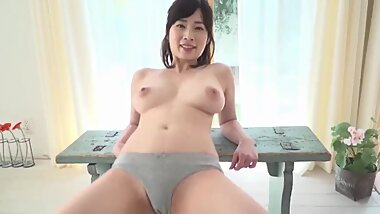Pretty Japanese woman with big tits showing off her panties JAV